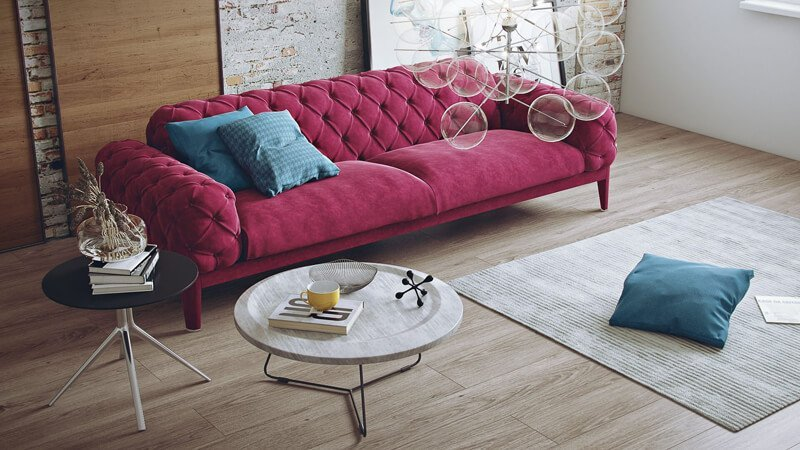 A Lifestyle Pic of a Sofa with 3D Models as Props