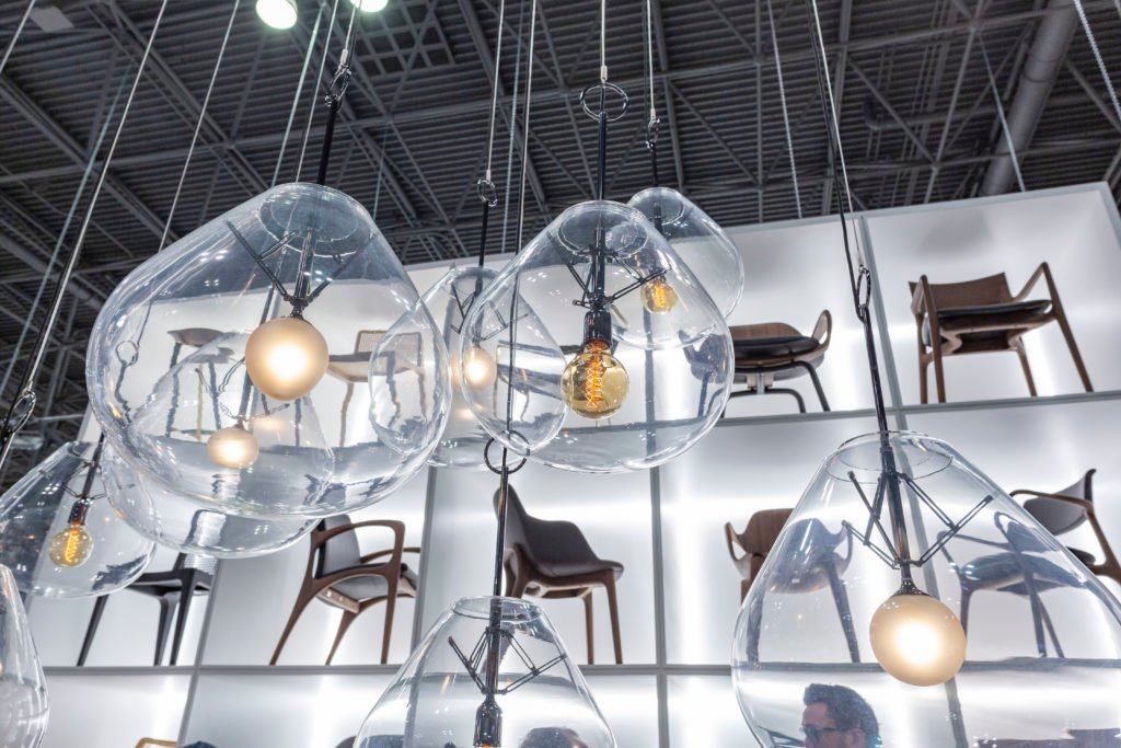 Chairs and Lighting Fixtures Showcased on an Exhibition