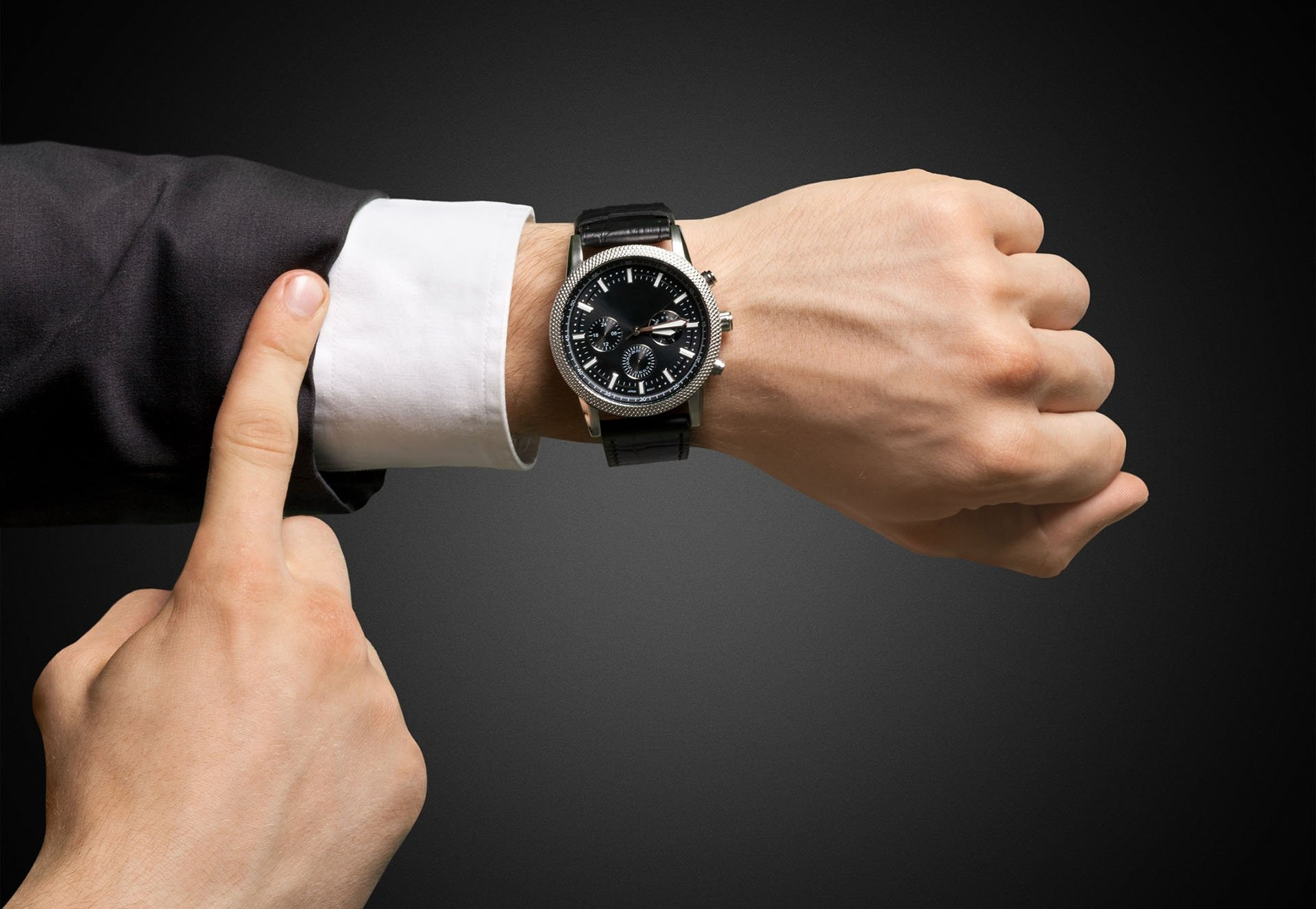 Architect Pointing at a Watch