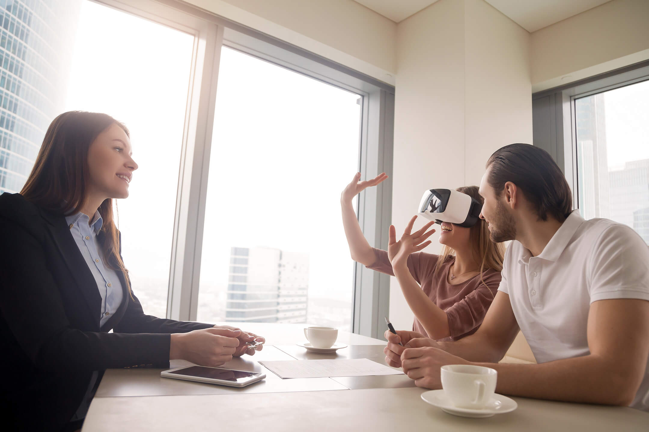 Prospects Having a VR Experience at a Real Estate Sales Office
