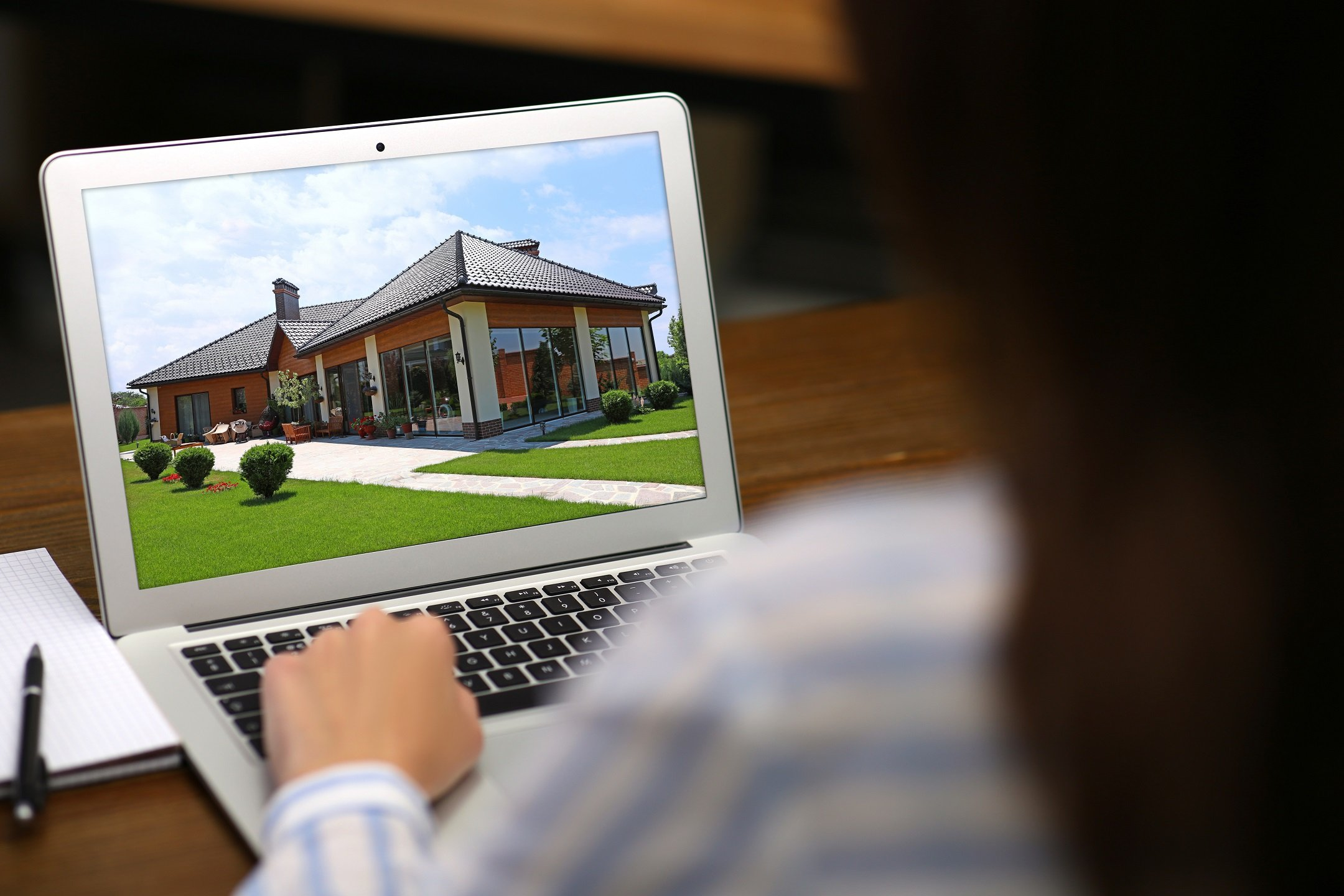 Woman Looking at a Video of an Open House
