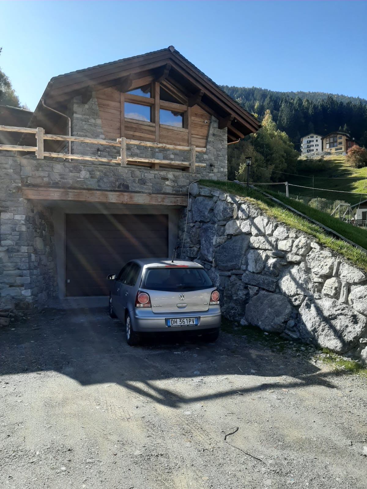 House Exterior Photo Showcasing the Garage and Stairs